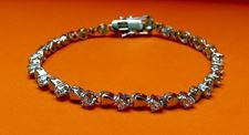 "Picture of ""A Heart for Zirconia"" tennis bracelet in sterling silver and round cubic zirconia"