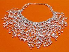 """Picture of """"Cascade of pearls"""" bib necklace in white cultured pearls with silver"""